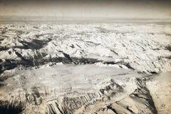 Vista aerea delle montagne nevose delle alpi Immagine Stock Libera da Diritti