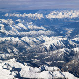 Vista aerea delle montagne nevose delle alpi Fotografia Stock Libera da Diritti