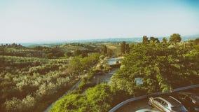 Vista aerea di bella campagna della Toscana al crepuscolo, l'Italia Fotografie Stock