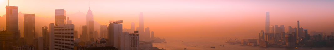 Vista aerea di panorama di paesaggio urbano di Hong Kong al tramonto Fotografia Stock