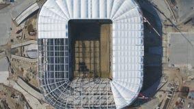 Vista aerea su costruzione e su ricostruzione di stadio di football americano Ricostruzione dello stadio per ospitare le partite  fotografia stock