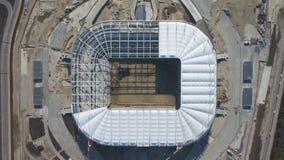 Vista aerea su costruzione e su ricostruzione di stadio di football americano Ricostruzione dello stadio per ospitare le partite  fotografia stock libera da diritti