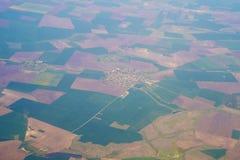 Vista aerea variopinta dei campi Immagini Stock