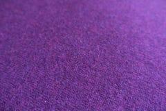 Vista cercana de la tela de lana del punto de la violeta Fotos de archivo libres de regalías