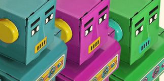 Vista colorida de três robôs sobre Foto de Stock