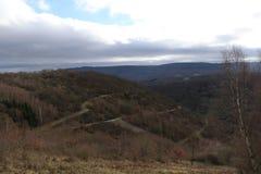Vista colorida em montes e em árvores durante um dia de invernos suave, área de Manubach, Alemanha Fotografia de Stock
