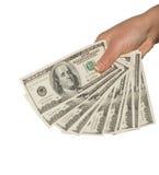 Hombre que lleva a cabo un fistful de 100 billetes de dólar Fotos de archivo