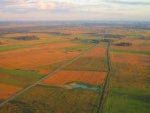 Vista da janela no outono, Lituânia do avião Imagens de Stock Royalty Free