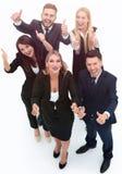 Vista da parte superior sustentação feliz da equipe do negócio polegares acima imagem de stock