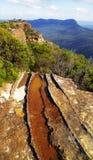 Vista dall'allerta della frana, montagne blu Immagini Stock