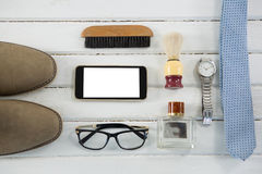 Vista de arriba de accesorios personales en la tabla Imagen de archivo libre de regalías