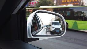 Vista de espelhamento de carro do tráfego em Xian vídeos de arquivo