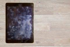 Vista de huellas dactilares y de la grasa en la pantalla de la tableta Imágenes de archivo libres de regalías