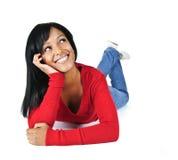 Vista de relaxamento de sorriso da mulher nova acima Imagens de Stock Royalty Free