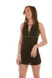 Vista de riso do brunette bonito lateralmente Fotos de Stock Royalty Free