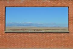 Vista del deserto incorniciata in muro di mattoni Arizona Fotografia Stock Libera da Diritti