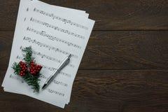 Vista del fondo di cui sopra di concetto di Buon Natale e di musica Fotografia Stock