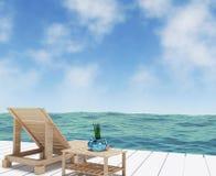 Vista del mare con il salotto della spiaggia per la vacanza nella rappresentazione 3D Immagini Stock Libere da Diritti