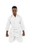Vista delantera de meditar del combatiente del karate Fotografía de archivo libre de regalías