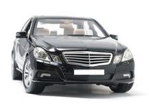 Vista delantera del coche de lujo negro aislado en blanco Imagenes de archivo