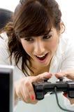Vista delantera del juego de video de goce femenino Imágenes de archivo libres de regalías