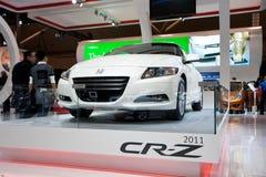 Vista delantera del vehículo 2011 del híbrido de Honda CR-Z Foto de archivo