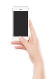 Vista delantera directamente de un teléfono elegante móvil blanco moderno en el fema Fotos de archivo libres de regalías