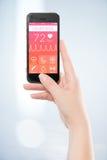Vista delantera directamente de un teléfono elegante móvil negro con la salud BO Imagen de archivo