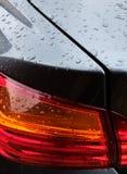 Vista della porta posteriore di nuovo, dell'automobile sportiva fatta tedesca che mostra il mazzo della luce posteriore ed il tro fotografia stock libera da diritti