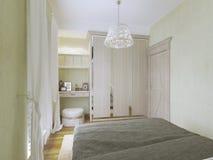 Vista della tavola e del guardaroba di condimento in camera da letto moderna Fotografia Stock