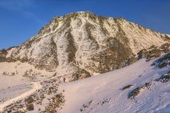 Vista di grande couloir al tramonto nelle alpi francesi Fotografia Stock