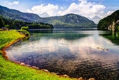 Vista di superficie del lago Alpsee, Baviera Germania Immagini Stock