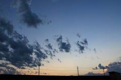 Vista di tramonto nel villaggio Immagini Stock