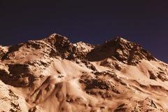 Vista e colore stupefacenti di una montagna nevosa nelle alpi Svizzera Immagine Stock