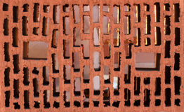 Vista frontale del mattone rosso con i fori Fotografie Stock Libere da Diritti
