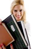 Vista frontale dell'allievo sorridente con i libri Fotografia Stock Libera da Diritti