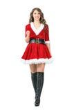 Vista frontale di bella giovane Santa Claus femminile che cammina verso la macchina fotografica immagine stock