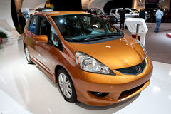 Vista frontale di una misura metallica arancione della Honda Fotografie Stock