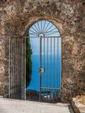 Vista through a gate onto the sea, Croatia Stock Images