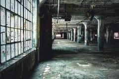 Vista interior de la fábrica abandonada de Fisher Body Plant en Detroit La planta está abandonada y vacante desde que imagen de archivo libre de regalías