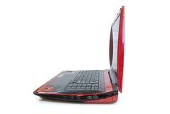 Vista lateral de la computadora portátil roja. Foto de archivo libre de regalías