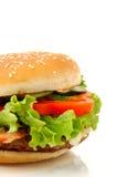Vista lateral de la hamburguesa grande aislada Fotos de archivo