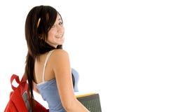 Vista lateral de la muchacha de universidad con el bolso y los libros Fotografía de archivo libre de regalías