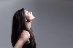 Vista lateral de la mujer hermosa Imagen de archivo libre de regalías