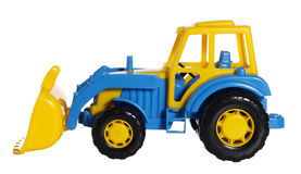Vista lateral de la niveladora del tractor del juguete Imagen de archivo