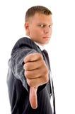 Vista lateral del hombre de negocios con los pulgares abajo Imagen de archivo libre de regalías
