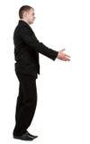 Vista lateral del hombre de negocios en apretón de manos negro del traje. Imagen de archivo libre de regalías
