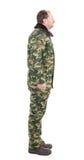 Vista lateral del hombre en traje de los militares Imagen de archivo libre de regalías