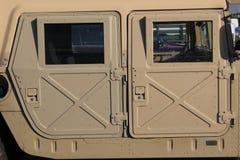 Vista lateral del humvee militar Foto de archivo libre de regalías