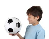 Vista lateral del muchacho con el balón de fútbol Foto de archivo libre de regalías